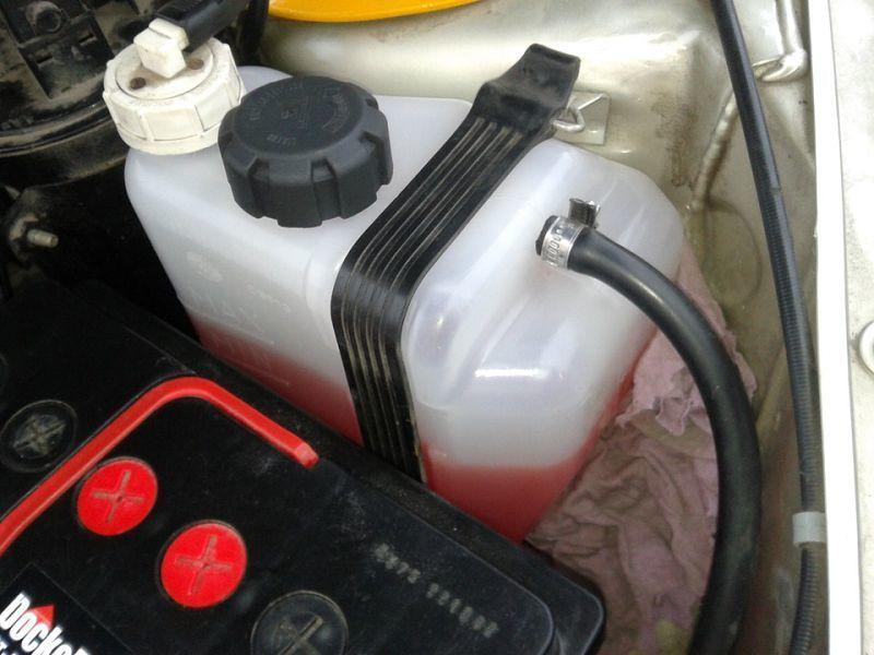 Слив тосола из радиатора двигателя