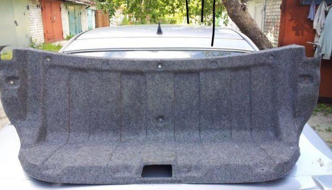 Обшивка крышки багажника лансер 9