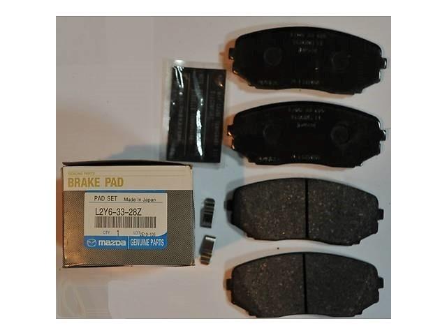 Комплект оригинальных передних дисковых тормозных колодок