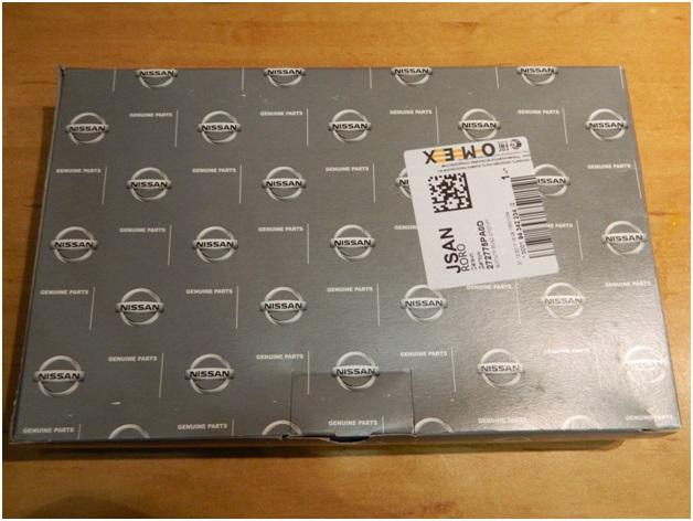 Упаковка оригинального фильтра, на которой указана компания Nissan